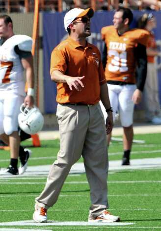 Texas defensive coordinator Manny Diaz shouts to his players at the Orange and White spring football game, Sunday, April 1, 2012, in Austin. Photo: Michael Thomas, Associated Press