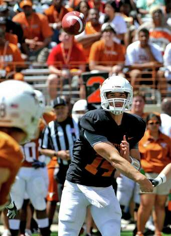 Texas quarterback David Ash throws the ball during the first quarter of the Texas Orange and White spring football game, Sunday, April 1, 2012, in Austin. Photo: Michael Thomas, Associated Press