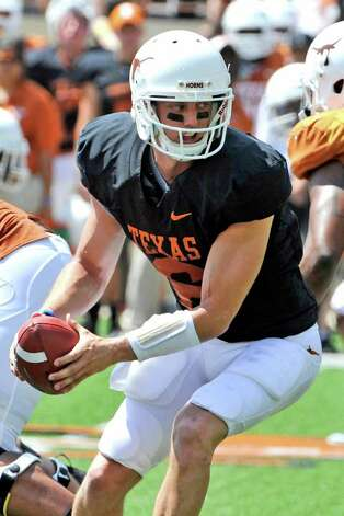 Texas quarterback Case McCoy looks to hand the ball off during the first quarter of the Orange and White spring football game, Sunday, April 1, 2012, in Austin. Photo: Michael Thomas, Associated Press
