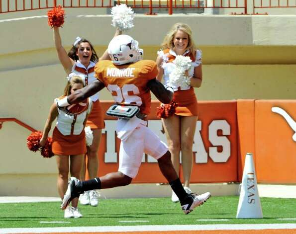 Texas running back D.J. Monroe high steps into the end zone after a long run in the first quarter of the Orange and White spring football game, Sunday, April 1, 2012, in Austin. Photo: Michael Thomas, Associated Press