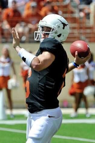 Texas quarterback Case McCoy throws the ball during the first quarter of the Orange and White spring football game, Sunday, April 1, 2012, in Austin. Photo: Michael Thomas, Associated Press