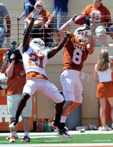 Texas receiver Jaxon Shipley (right) catches a touchdown pass against  defensive back Duke Thomas (left) during the first quarter of the Orange and White spring football game at Darrell K. Royal-Texas Memorial Stadium, Sunday, April 1, 2012, in Austin. Photo: Michael Thomas, Associated Press