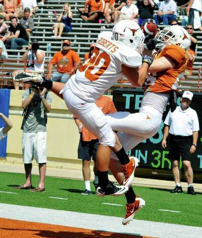 Texas wide receiver Cade McCrary (right) comes down with a touchdown catch against cornerback Ryan Roberts (left) during the second quarter of the Orange and White spring football game, Sunday, April 1, 2012, in Austin. Photo: Michael Thomas, Associated Press