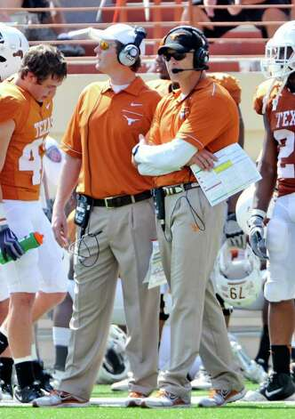 Texas' co-offensive coordinators Major Applewhite (left) and Bryan Harsin (right) watch the offense during the Orange and White spring football game, Sunday, April 1, 2012, in Austin. Photo: Michael Thomas, Associated Press