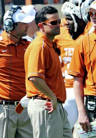 Texas defensive coordinator Manny Diaz watches during the Orange and White spring football game, Sunday, April 1, 2012, in Austin. Photo: Michael Thomas, Associated Press