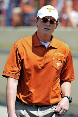 Texas co-offensive coordinator Major Applewhite watches before the start of the Orange and White spring football game, Sunday, April 1, 2012, in Austin. Photo: Michael Thomas, Associated Press