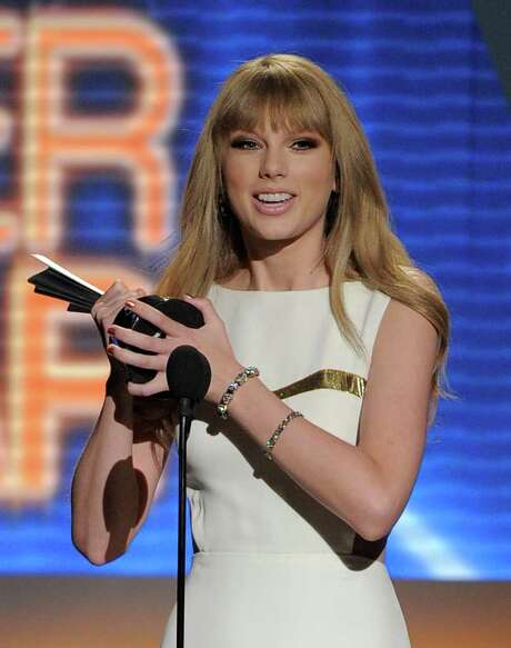 Taylor Swift accepts the award for entertainer of the year at the 47th Annual Academy of Country Music Awards in Las Vegas. Photo: Associated Press
