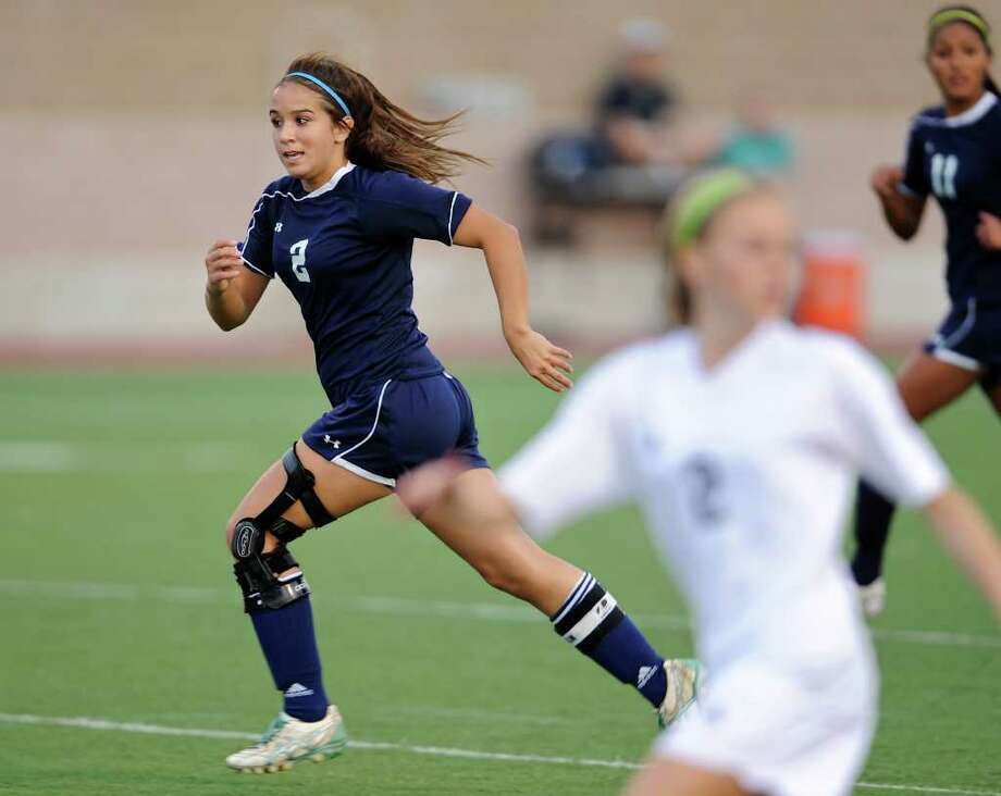 O'Connor's Brittany Jasper (left) races upfield during last week's district game against Clark at Farris Stadium. Jasper has rebounded from a devastating knee injury to lead the Panthers this season with 15 goals heading into tonight's bidistrict game at Southwest. Photo: John Albright, For The Express-News