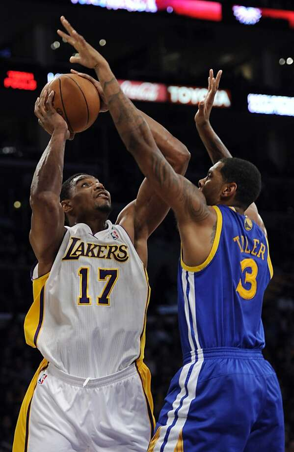 Los Angeles Lakers center Andrew Bynum (17) goes up for a basket over Golden State Warriors forward Jeremy Tyler (3) during the first half of an NBA basketball game in Los Angeles , Sunday, April 1, 2012. (AP Photo/Lori Shepler) Photo: Lori Shepler, Associated Press