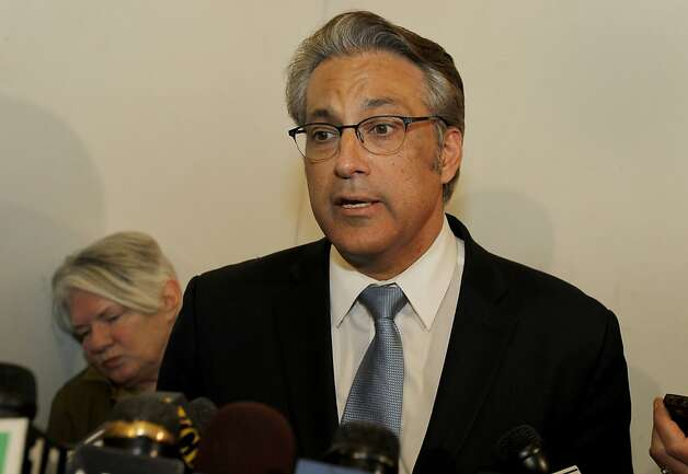 Sheriff Ross Mirkarimi read a statement saying he has no plans to resign and had a cordial discussion with the mayor. In background is his spokesperson Susan Fahey. San Francisco Sheriff Ross Mirkarimi appeared outside his City Hall offices to say he has no plans to resign his job. Photo: Brant Ward, The Chronicle