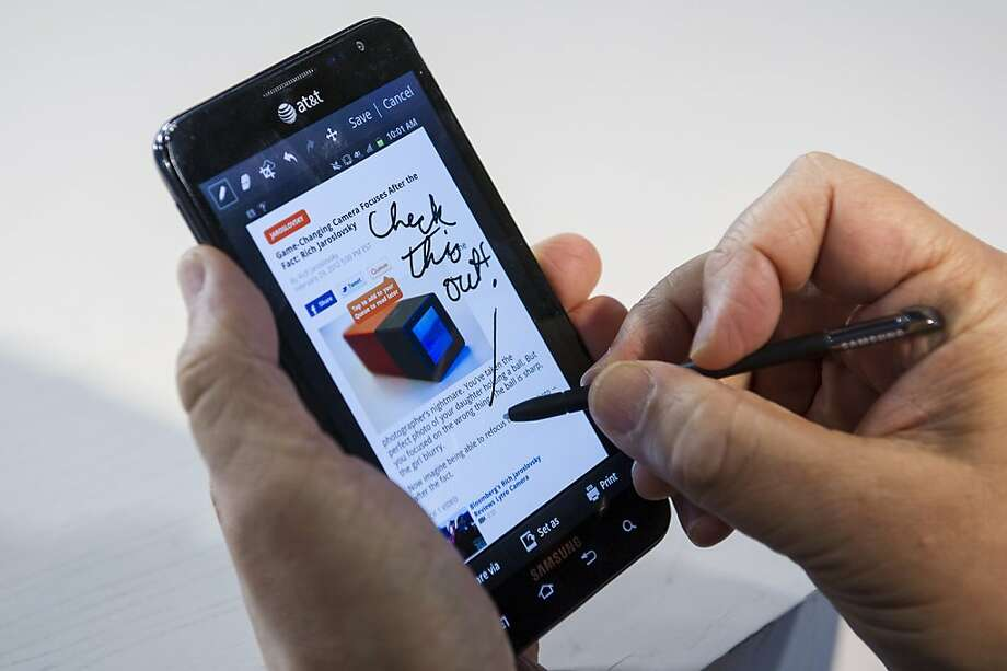 The Samsung Electronics Co. Ltd. Galaxy Note is demonstrated for a photograph in San Francisco, California, U.S., on Tuesday, Mar. 6, 2012. Samsung's new Galaxy Note shows that a stylus -- or pen, as the company insists on referring to it -- can be useful and even fun, especially for scrawling an on-screen annotation or for creative types who want to dash off a quick sketch on its 5.3-inch screen. Photographer: David Paul Morris/Bloomberg Photo: David Paul Morris, Bloomberg