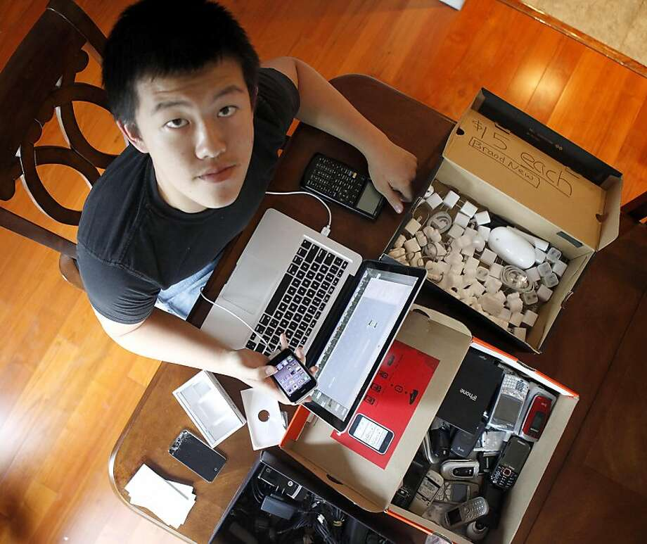 "Jason Li normally works on the recycled electronics in his garage or his dinning room table. Jason Li is a 15-year-old who created iReTron, a electronics recycling website. Jason won a ""next teen tycoon"" contest on Youtube. Photo: Sean Culligan, The Chronicle"