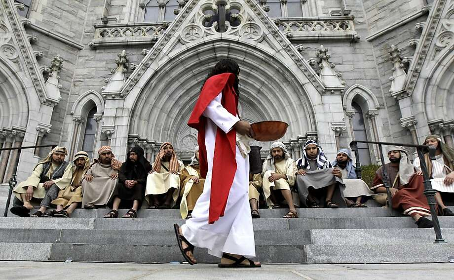 David Amador, 26, center front, playing the role of Jesus, performs with a group of actors during a passion play showing at Cathedral Basilica of the Sacred Heart, Sunday, April 1, 2012, in Newark, N.J. Catholics in Northern New Jersey kicked off Holy Week with the observance of Palm Sunday. (AP Photo/Julio Cortez) Photo: Julio Cortez, Associated Press