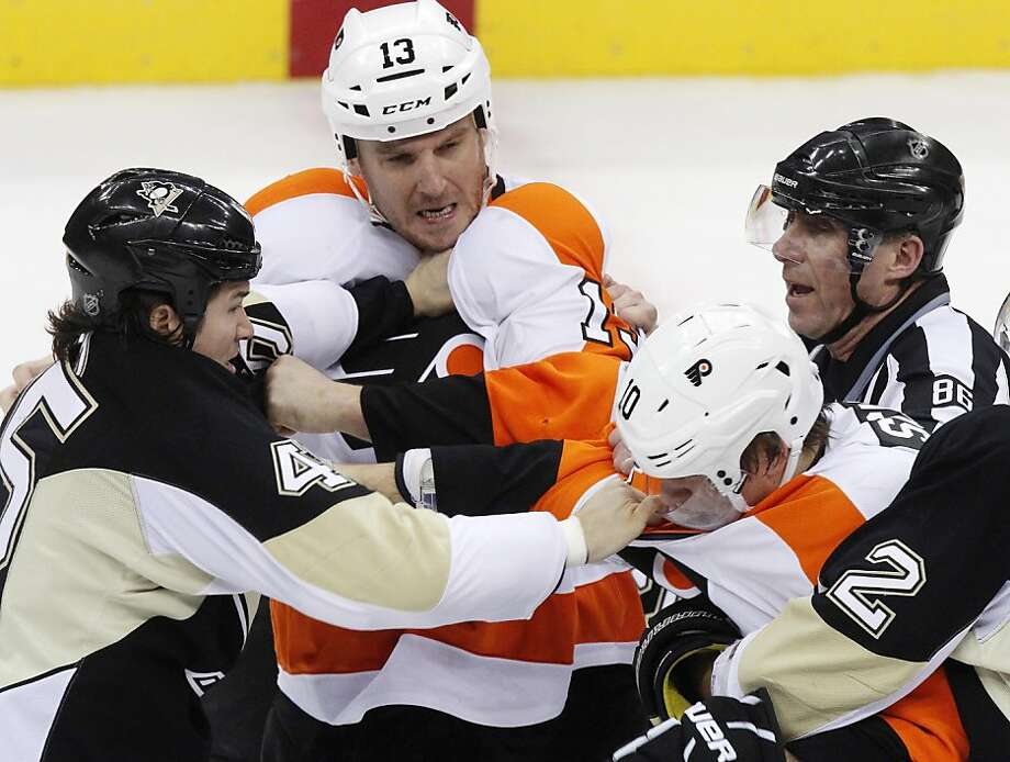 Philadelphia Flyers' Pavel Kubina (13) and Brayden Schenn (10) both tangle with Pittsburgh Penguins' Aaron Asham, left, during a third-period fight, as linesmen Brad Lazarowich (86) tries to separate them in the final minute of an NHL hockey game in Pittsburgh Sunday, April 1, 2012. The Flyers won 6-4. (AP Photo/Gene J. Puskar) Photo: Gene J. Puskar, Associated Press