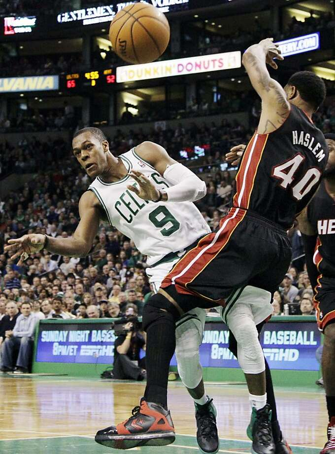 Boston Celtics point guard Rajon Rondo (9) passes the ball after driving against Miami Heat power forward Udonis Haslem (40) in the second half of an NBA basketball game in Boston, Sunday, April 1, 2012. Rondo had a triple-double as the Celtics won 91-72. (AP Photo/Elise Amendola) Photo: Elise Amendola, Associated Press