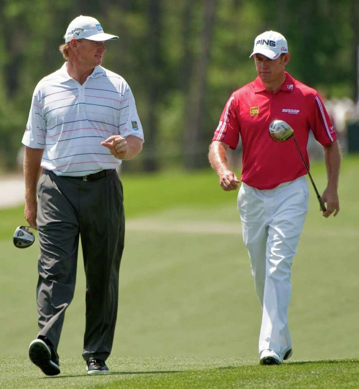 Ernie Els, left, of South Africa, and Lee Westwood, right, of England, walk up the 8th hole during the final round of the Houston Open golf tournament, Sunday, April 1, 2012, in Humble.