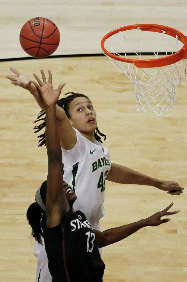 Baylor center Brittney Griner (42) and Stanford forward Chiney Ogwumike (13) battle for control of the ball during the first half in the NCAA women's Final Four semifinal college basketball game, in Denver, Sunday, April 1, 2012. Photo: David Zalubowski, Associated Press
