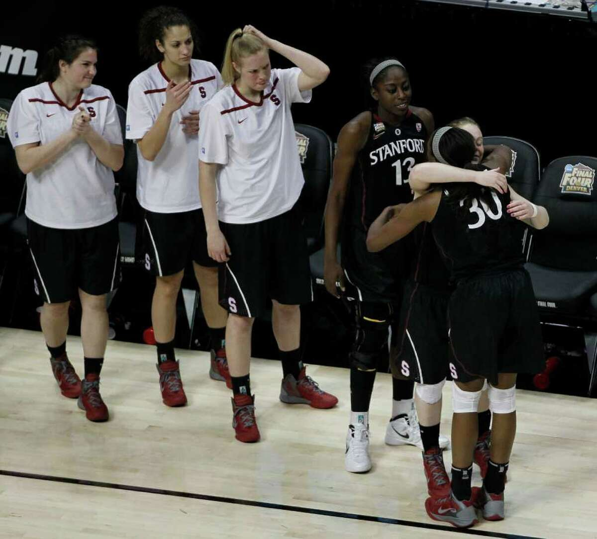 Stanford forward Nnemkadi Ogwumike (30) hugs Stanford guard Lindy La Rocque (15) as the team watches after the NCAA women's Final Four semifinal college basketball game against the Baylor, in Denver, Sunday, April 1, 2012. Baylor defeated Stanford 59-47.