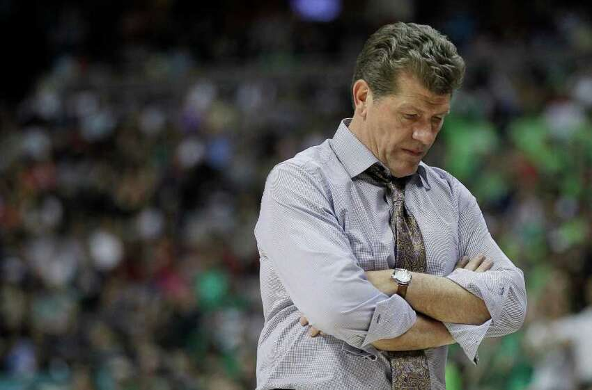 Connecticut head coach Geno Auriemma walks near the bench during overtime in the NCAA women's Final Four semifinal college basketball game against Notre Dame, in Denver, Sunday, April 1, 2012. Notre Dame won 83-75.