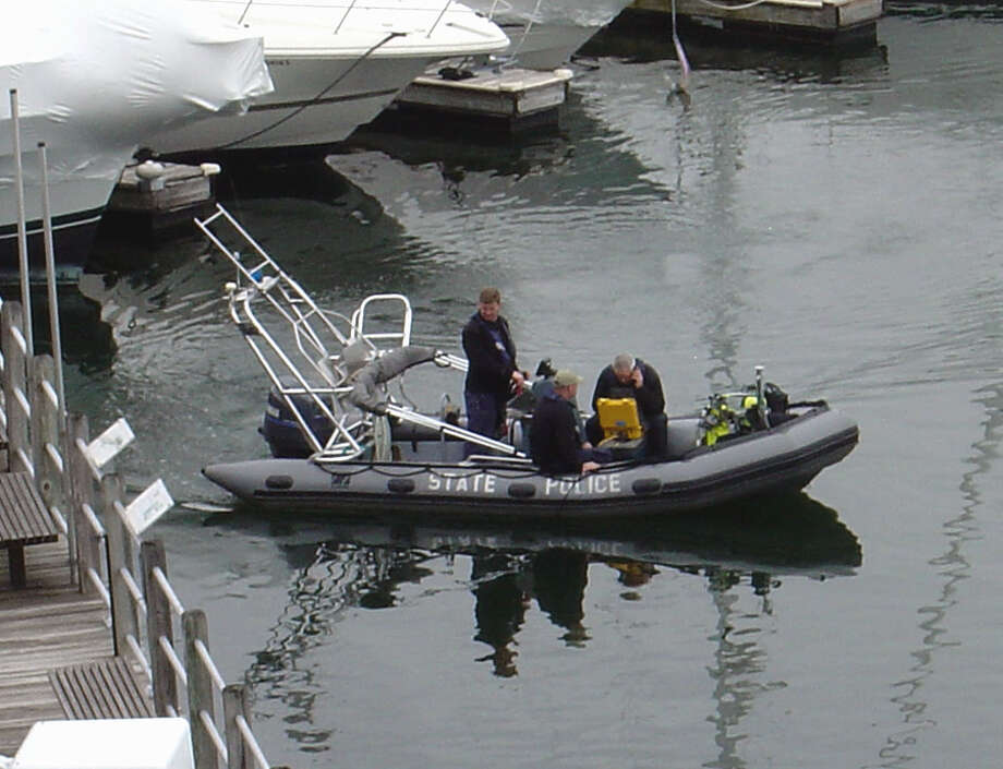 Police investigating a missing persons report on Sunday, April, 1, 2012 found the body of a man under his boat who apparently drowned. Police have not released the name of the 68-year-old resident of Stamford Landing pending notification of his relatives. Photo: Doug Harrison/Contributed Photo / Stamford Advocate Contributed