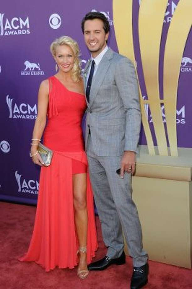 LAS VEGAS, NV - APRIL 01:  Musician Luke Bryan (R) and Caroline Bryan arrive at the 47th Annual Academy Of Country Music Awards held at the MGM Grand Garden Arena on April 1, 2012 in Las Vegas, Nevada.  (Photo by Jason Merritt/Getty Images) (Jason Merritt / Getty Images)