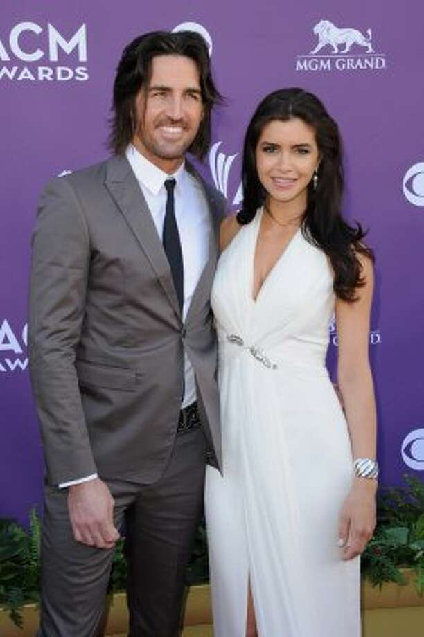 LAS VEGAS, NV - APRIL 01:  Singer Jake Owen (L) and Lacey Buchanan arrive at the 47th Annual Academy Of Country Music Awards held at the MGM Grand Garden Arena on April 1, 2012 in Las Vegas, Nevada.  (Photo by Jason Merritt/Getty Images) (Jason Merritt / Getty Images)