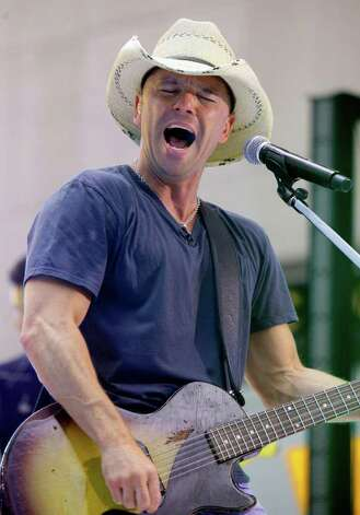 "FILE - In this June 17, 2011 file photo, singer Kenny Chesney performs on the NBC ""Today"" television program in New York. Chesney is up for nine Academy of Country Music Awards on Sunday, April 1, 2012. Photo: Richard Drew"