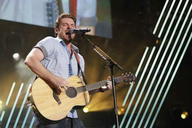 FILE - In this June 11, 2011 file photo, Chris Young performs during the CMA Fan Fest in Nashville, Tenn.  Young is up for male vocalist of the year for the Academy of Country Music Awards on Sunday, April 1, 2012, in Las Vegas. Photo: Wade Payne