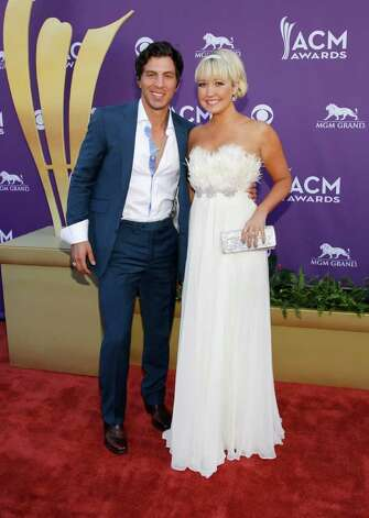 Joshua Scott Jones, left, and Meghan Linsey, of musical group Steel Magnolia, arrive at the 47th Annual Academy of Country Music Awards on Sunday, April 1, 2012 in Las Vegas. Photo: Isaac Brekken