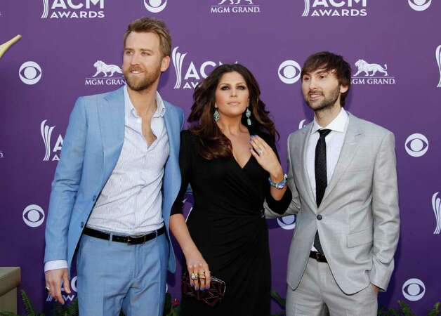 From left, Charles Kelley, Hillary Scott and Dave Haywood, of musical group Lady Antebellum, arrive at the 47th Annual Academy of Country Music Awards on Sunday, April 1, 2012 in Las Vegas. Photo: Isaac Brekken