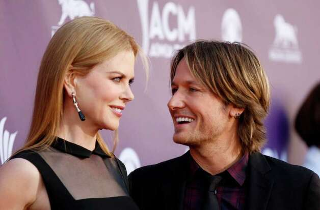 Nicole Kidman, left, and Keith Urban arrive at the 47th Annual Academy of Country Music Awards on Sunday, April 1, 2012 in Las Vegas. Photo: Isaac Brekken