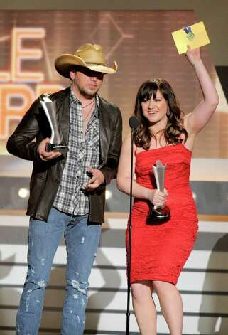 "Jason Aldean, left, and Kelly Clarkson accept the award for single of the year for ""Don't You Wanna Stay"" at the 47th Annual Academy of Country Music Awards on Sunday, April 1, 2012 in Las Vegas. Photo: Mark J. Terrill"