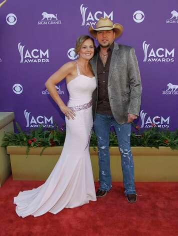 Jason Aldean, left, and Jessica Aldean arrive at the 47th Annual Academy of Country Music Awards on Sunday, April 1, 2012 in Las Vegas. Photo: Isaac Brekken