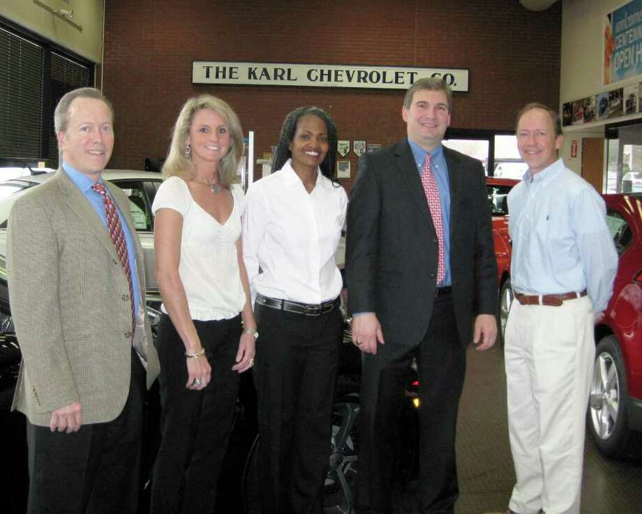 From left, Leo E. Karl III, President of KARL Chevrolet; Lisa Isherwood and Annette Terry, co-chairmen of the New Canaan High School Scholarship Foundationís Finance Committee with Liz Mallozzi (not pictured); Dr. Bryan Luizzi, New Canaan High School principal; and Stephen J. Karl, vice president of KARL Chevrolet. Photo: Contributed Photo