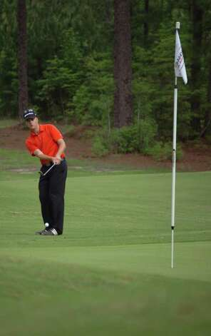 Devin Carrey chips the ball up within inches of the hole on the last hole of the front nine in the final round. Photo: Jimmy Galvan