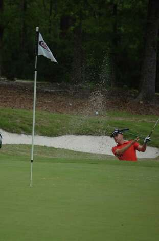 Devin Carrey blasts his way out of the sand trap on the back nine of the final round. Photo: Jimmy Galvan