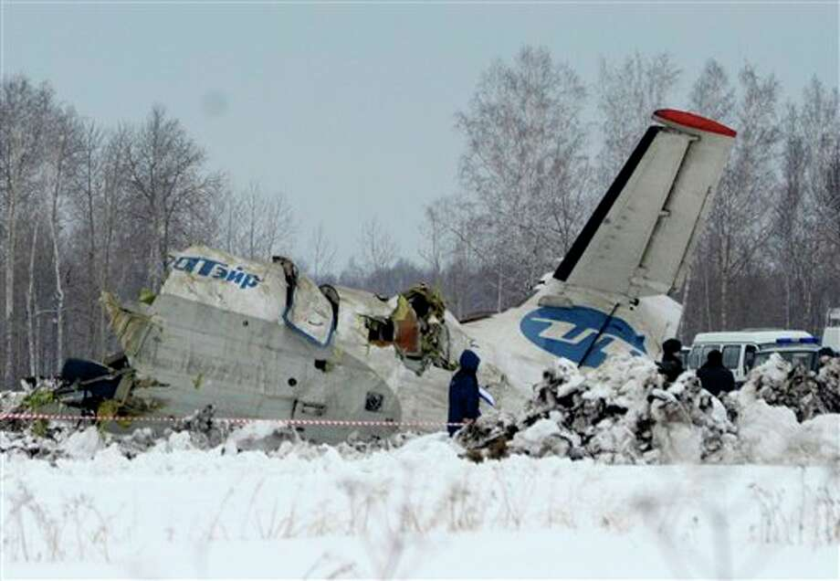Russian Emergency ministry rescue workers search the site of the ATR-72 plane crash outside Tyumen, a major regional center in Siberia, Russia. A passenger plane crashed in Siberia shortly after take-off on Monday morning, killing 31 of the 43 people aboard, Russian emergency officials said, with 12 survivors were hospitalized in serious condition. The ATR-72, a French-Italian-made twin-engine turboprop, operated by UTair was flying from Tyumen to the oil town of Surgut with 39 passengers and four crew. Photo: AP