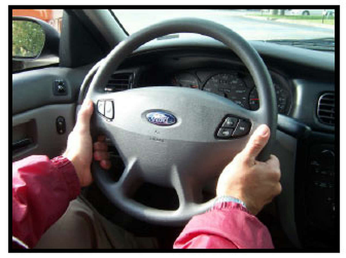 How should you grip the steering wheel? Both hands should be placed out of the steering wheel on opposite sides. Your grip should be firm, yet gentle. Use your fingers instead of the palms of your hands and keep your thumbs up along the face of the steering wheel. Never turn the wheel while gripping it from the inside.