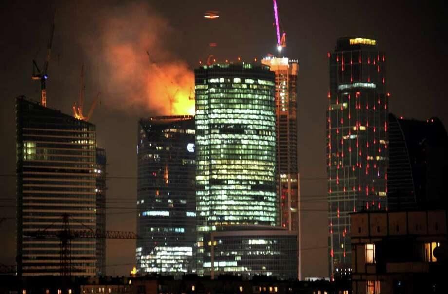 Europe's tallest-to-be tower under-construction burns  in central Moscow, late on April 2, 2012. No injuries have been reported at the fire in the eastern tower of the Federation Tower complex, some 2 km  west of the Kremlin. The tower, when completed, is to be 360 meters (1150 feet) tall.  AFP PHOTO / ALEXANDER NEMENOV Photo: ALEXANDER NEMENOV, AFP/Getty Images / AFP