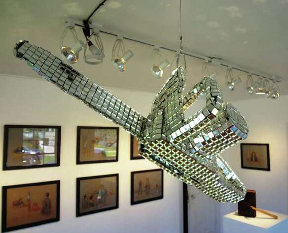 "The Art Guys discofied chain saw is featured in the exhibition ""The State of Texas v. Gary Sweeney v. The Art Guys"" at Unit B (Gallery)."