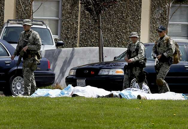 Armed SWAT members walked by the bodies of those killed at Oikos. Seven people were shot and killed at Oikos University on Edgewater Street in Oakland, Calif. Monday April 2, 2012. Photo: Brant Ward, The Chronicle