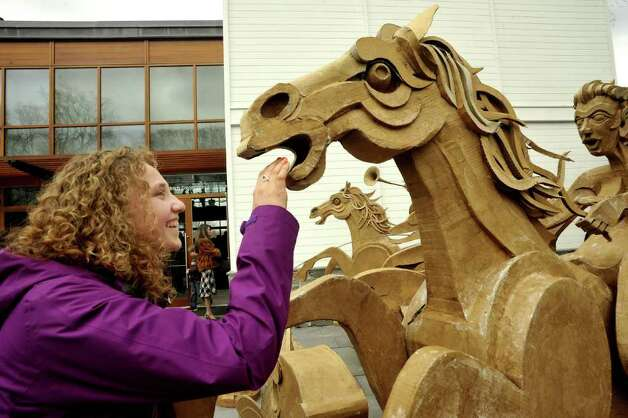 "Sara Gardner, 17, of Wilton, examines James Grashow's ""Corrugated Fountain"" at the Aldrich Museum in Ridgefield Sunday, April 1, 2012. Photo: Michael Duffy / The News-Times"