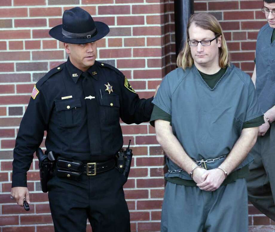 Brent Dickinson is lead from the Saratoga County Courthouse where he appeared in front of Judge Jerry Scarano in Ballston Spa, N.Y. April 2, 2012.    (Skip Dickstein/Times Union) Photo: Skip Dickstein / 00017046A
