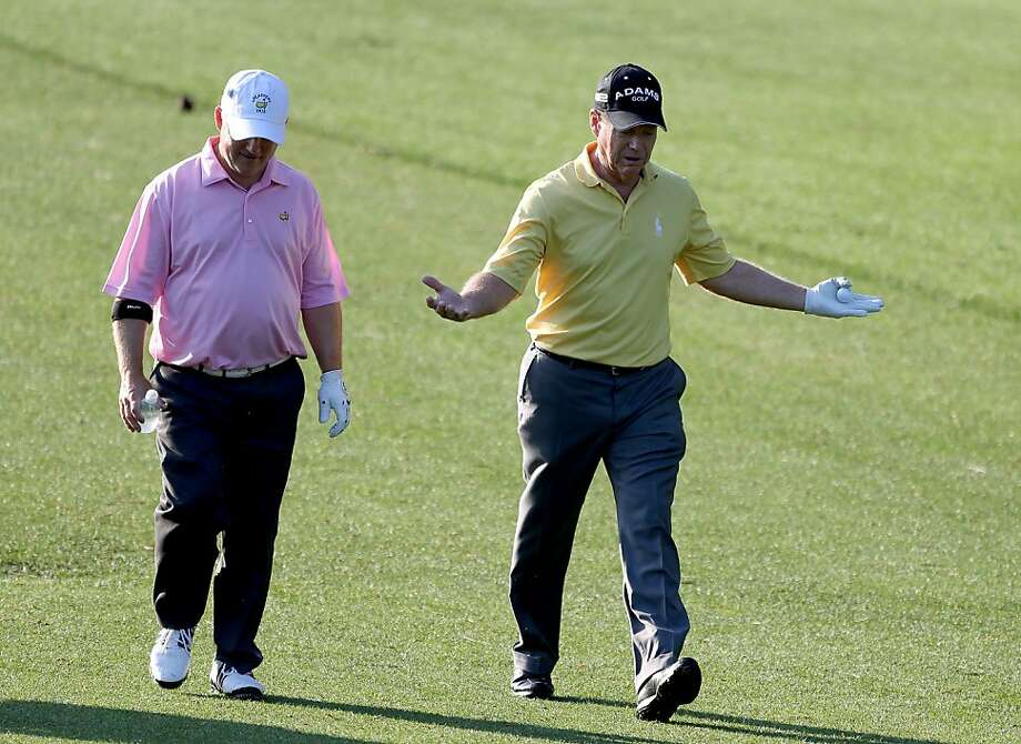 AUGUSTA, GA - APRIL 02:  Randal Lewis and Tom Watson walk up a fairway during a practice round prior to the start of the 2012 Masters Tournament at Augusta National Golf Club on April 2, 2012 in Augusta, Georgia.  (Photo by Andrew Redington/Getty Images) Photo: Andrew Redington, Getty Images