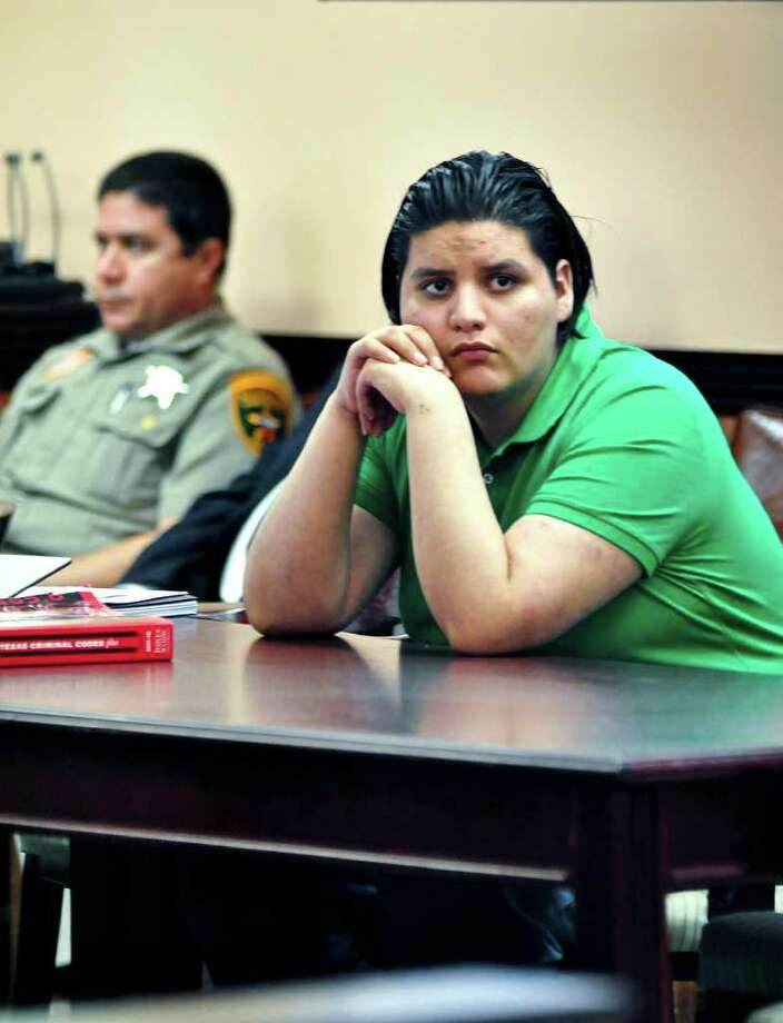 "Jose ""Lalo"" Eduardo Arredondo on trial for the capital murder and agravated sexual assualt of two year old Katherine Cardenas, looks on as a witness approaches the stand Monday  afternoon at the 49th District Court Room. Photo: Ulysses S. Romero / Laredo Morning Times"