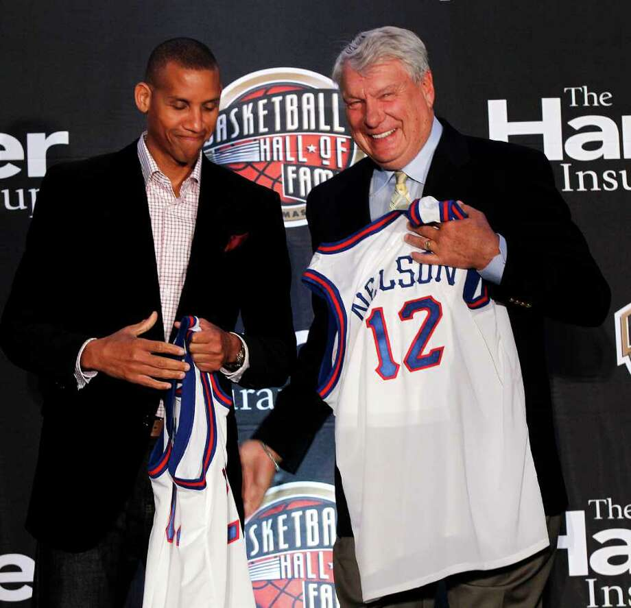 Naismith Memorial Basketball Hall of Fame inductees Reggie Miller, left, and Don Nelson, smile as they are introduced at a news conference in New Orleans, Monday, April 2, 2012. Photo: AP