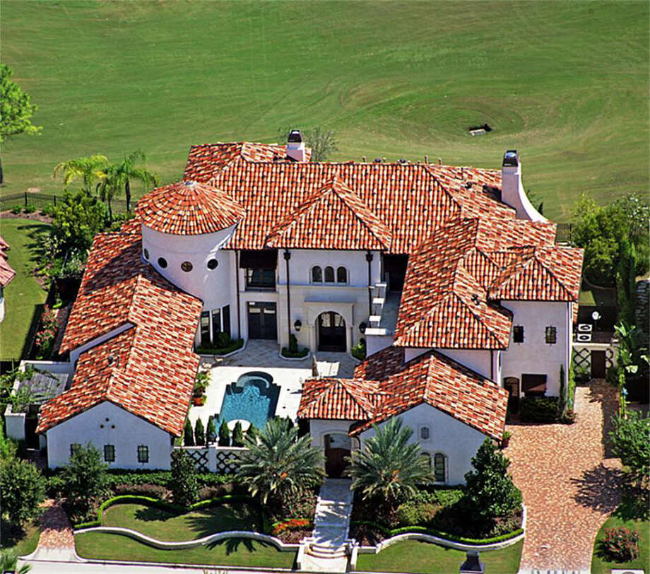 An aerial view of the property, revealing the lushly landscaped grounds and the villa-style design of the home. Photo: Realtor.com