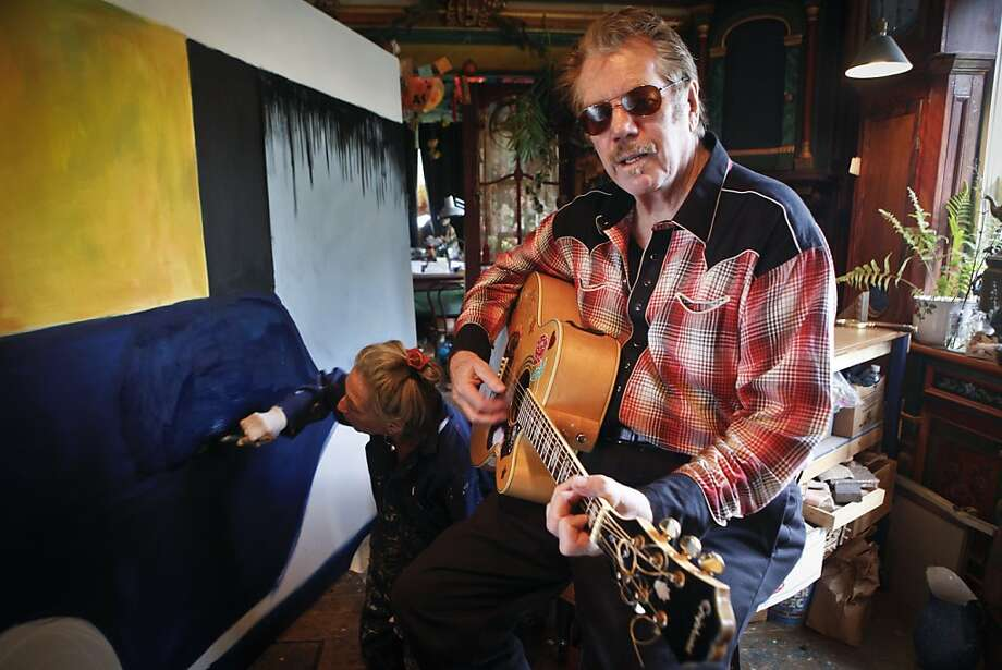 Musician Dan Hicks is seen in the studio where backgrounds for his 70th birthday concert at Davies Hall are being painted on Friday, March 23, 2012 in Mill Valley, Calif.  Painter Joan Reynolds is helping to paint the backgrounds. Photo: Russell Yip, The Chronicle