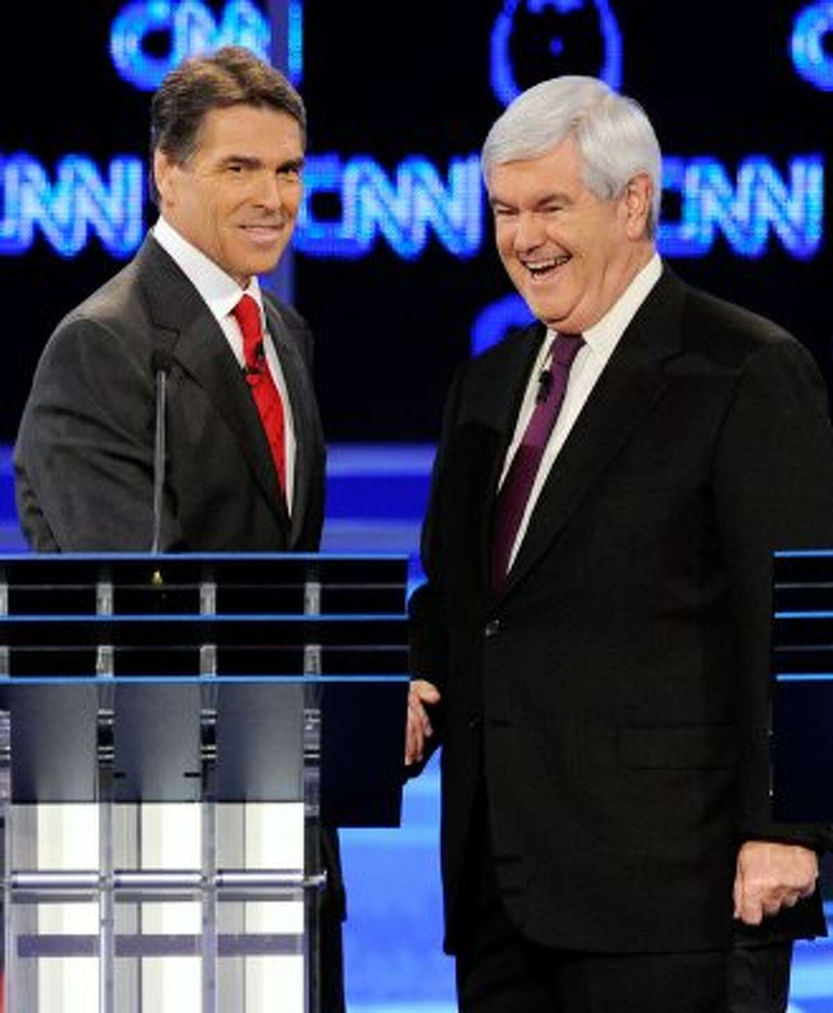 Rick Perry and former Speaker of the House Newt Gingrich shake hands after the Republican presidential debate airing on CNN, October 18, 2011 in Las Vegas. (Ethan Miller / Getty)