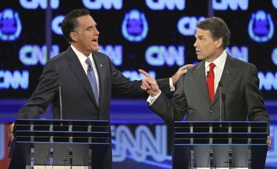 Mitt Romney and Rick Perry speak during a Republican presidential debate in Las Vegas. (Chris Carlso